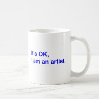 It s OK I am an artist Mugs