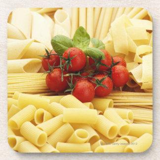 Italian cuisine. Pasta and tomatoes. Coaster