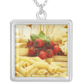 Italian cuisine. Pasta and tomatoes. Necklace
