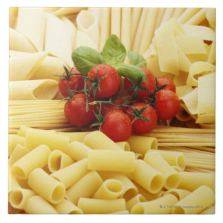Italian cuisine. Pasta and tomatoes. Tile