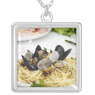 Italian cuisine. Spaghetti alle vongole. Necklace