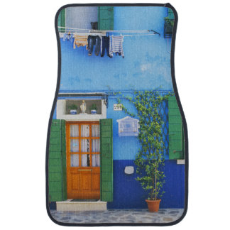 Italy, Burano. A colorful house in Burano near Car Mat