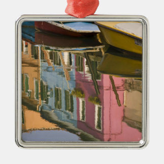 Italy, Burano. Boats on a canal with Christmas Ornament