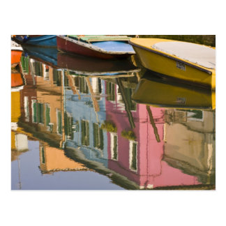 Italy, Burano. Boats on a canal with Postcard