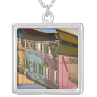 Italy, Burano. Boats on a canal with Silver Plated Necklace