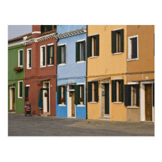 Italy, Burano. Colorful row of homes and empty Postcard