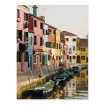 Italy, Burano. Colourful houses of line a Postcard