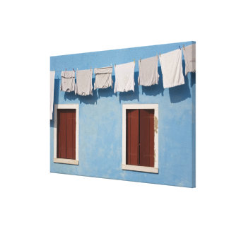 Italy, Burano. Hanging laundry and windows along Canvas Print
