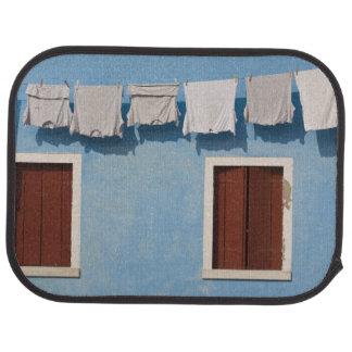 Italy, Burano. Hanging laundry and windows along Car Mat
