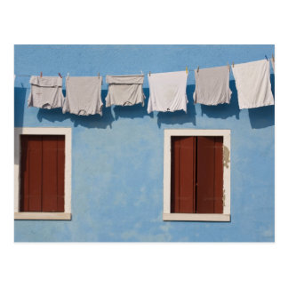 Italy, Burano. Hanging laundry and windows along Postcard