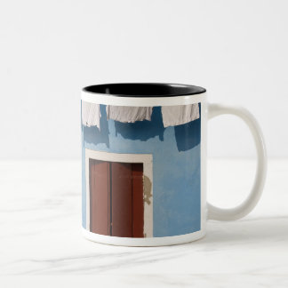 Italy, Burano. Hanging laundry and windows along Two-Tone Coffee Mug