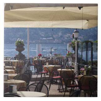 Italy, Como Province, Bellagio. Lakeside cafe. Tile