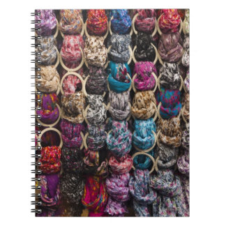 Italy, Florence, Colourful scarves outside shop Notebook