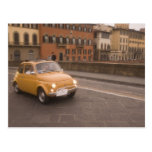 Italy, Florence. Fiat 800 Rally crosses Arno Postcard