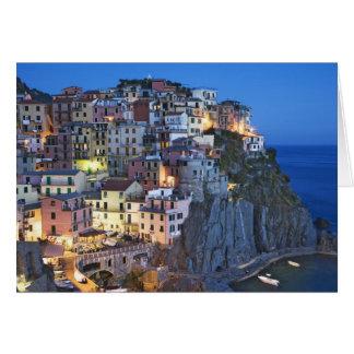 Italy, Manarola. Dusk falls on a hillside town Card