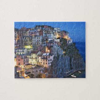 Italy, Manarola. Dusk falls on a hillside town Jigsaw Puzzle