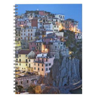 Italy, Manarola. Dusk falls on a hillside town Notebook