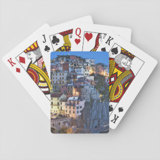 Italy, Manarola. Dusk falls on a hillside town Playing Cards