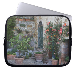 Italy, Petroio. Potted plants decorate a patio Laptop Sleeve