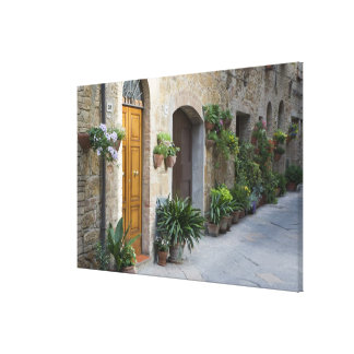 Italy, Pienza. Flower pots and potted plants Canvas Print