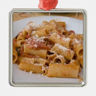 Italy, Positano. Display plate of rigatoni. Silver-Colored Square Decoration