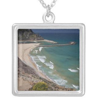 Italy, Sardinia, Buggerru. Buggerru beach and Silver Plated Necklace