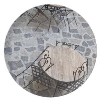 Italy, Sardinia, Castelsardo. Cafe tables. Plate