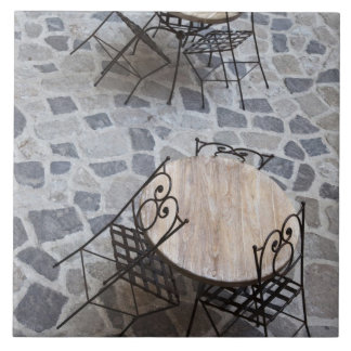 Italy, Sardinia, Castelsardo. Cafe tables. Tile