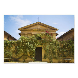 Italy, Tuscany, Old Rose Covered Church in Photograph