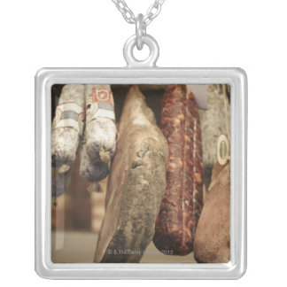 Italy,Tuscany,Pienza,Selection of local ham and Silver Plated Necklace