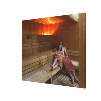 Italy, Tuscany, Young couple relaxing in sauna Canvas Print
