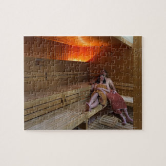 Italy, Tuscany, Young couple relaxing in sauna Jigsaw Puzzle