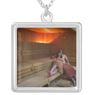 Italy, Tuscany, Young couple relaxing in sauna Silver Plated Necklace