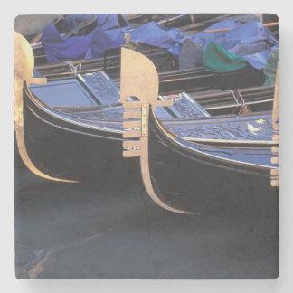 Italy, Veneto, Venice. Row of Gondolas. Stone Coaster