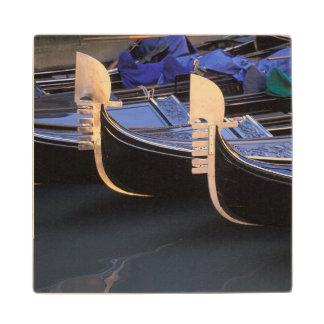 Italy, Veneto, Venice. Row of Gondolas. Wood Coaster