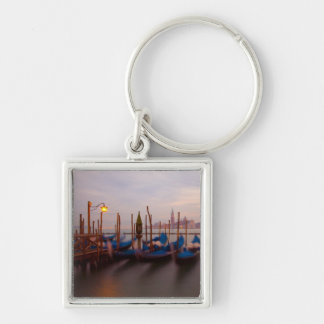Italy, Venice. Anchored gondolas at twilight. Key Ring