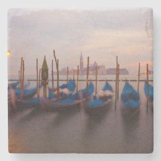 Italy, Venice. Anchored gondolas at twilight. Stone Coaster