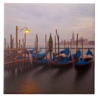 Italy, Venice. Anchored gondolas at twilight. Tile
