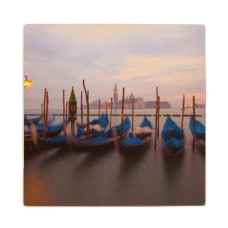 Italy, Venice. Anchored gondolas at twilight. Wood Coaster