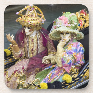 Italy, Venice. Couple dressed in costumes for Coaster