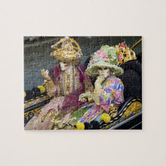 Italy, Venice. Couple dressed in costumes for Puzzles