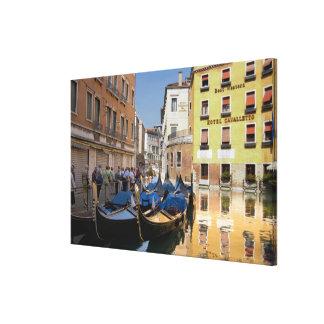 Italy, Venice, gondolas moored along canal Canvas Print