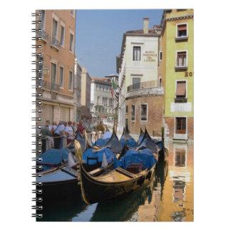 Italy, Venice, gondolas moored along canal Notebooks