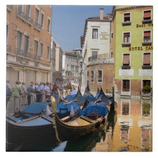 Italy, Venice, gondolas moored along canal Tile