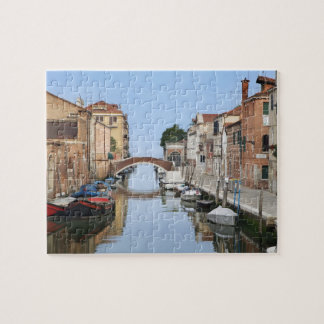 Italy, Venice. View of boats and homes along one Jigsaw Puzzle
