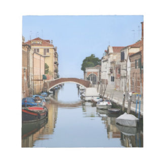 Italy, Venice. View of boats and homes along one Notepad