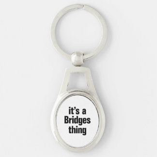its a bridges thing Silver-Colored oval keychain