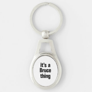 its a bruce thing Silver-Colored oval keychain