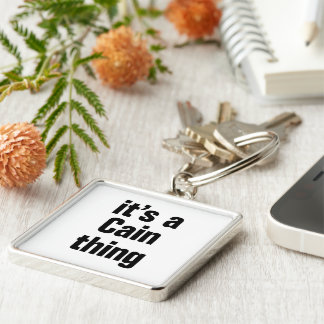 its a cain thing Silver-Colored square keychain