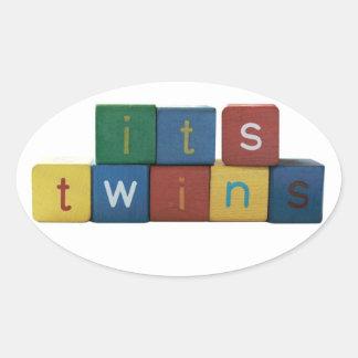 It's twins in children's block letters oval sticker